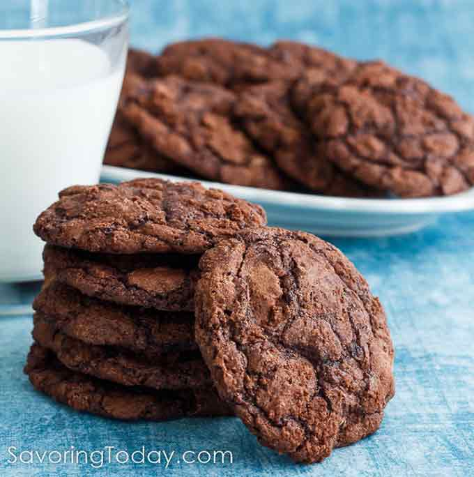 A stack of Brownie cookies with milk