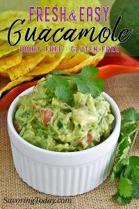 guacamole in a white ceramic dish with cilantro garnish