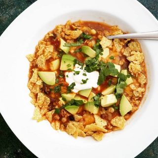 Chicken tortilla soup made with homemade broth and topped with fresh avocado and cilantro.
