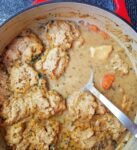 A stew pot with chicken and dumplings.