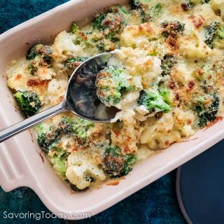 Broccoli and cauliflower baked in a cheese sauce scooped with a spoon.