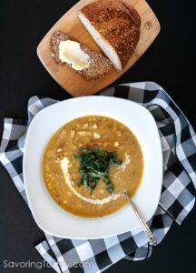 Chicken & Corn Chowder Recipe in a white bowl on a black background.