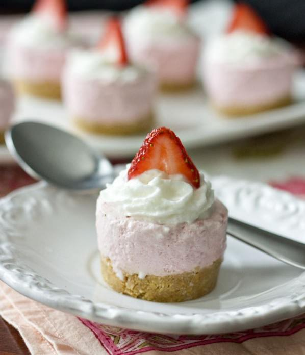 Strawberry Cheesecake Bites by Erica's Sweet Tooth. Graham cracker crust, strawberry mousse with whipped cream and sliced strawberry.