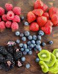 Kiwi, blackberries, raspberries, strawberries and blueberries for fruit tart.