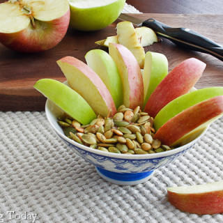 Fuji apple with almond butter dip for a healthy snack.