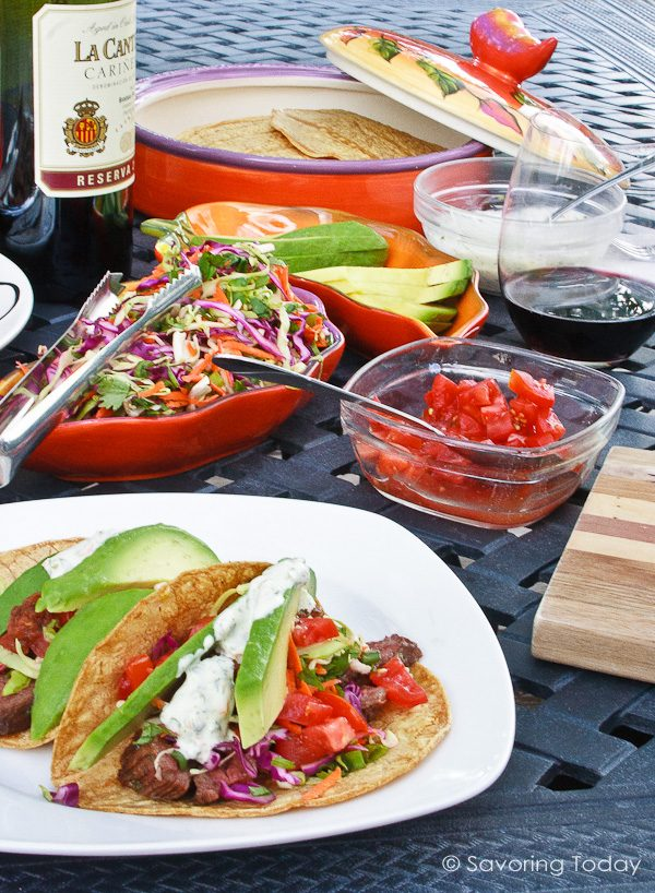 Grilled Skirt Steak Tacos served with pico and rainbow slaw.