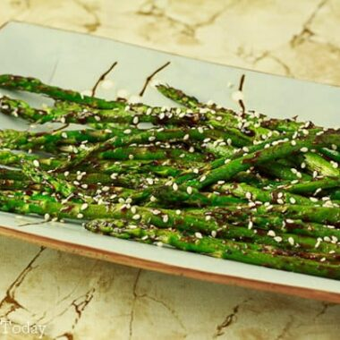Grilled asparagus with hoisin-sesame sauce makes an easy grilled side dish.