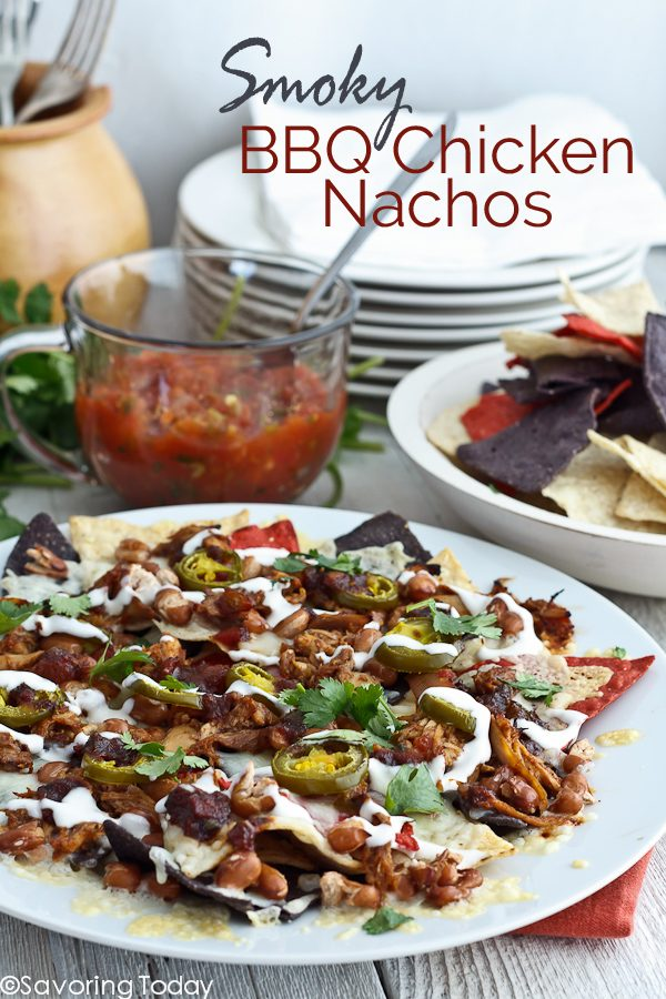 Super easy Super Bowl party appetizer recipe everyone loves. Smoky BBQ Chicken gives this nacho platter a new spin.