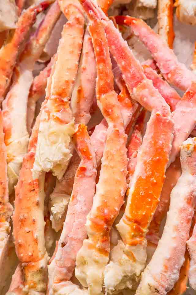 Frozen Crab Legs in a straight pile.