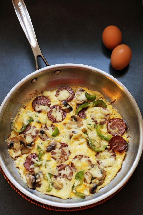 An open face omelette, eaten like a pizza!