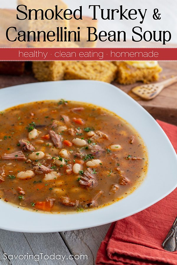 Turkey and Bean Soup in a white bowl with cornbread served on a cutting board.