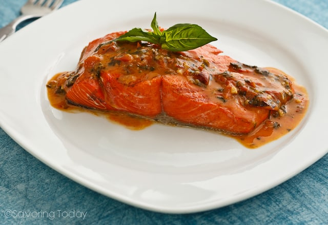Grilled Wild Salmon served with Tomato-Basil Butter Sauce, made from compound butter and white wine. Get the best 5 grilling tips for fish or salmon.