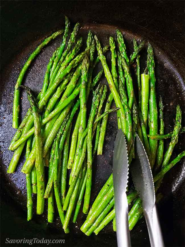 Roasted asparagus in a cast iron pan.