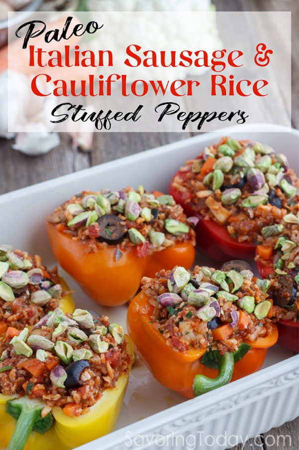 Stuffed peppers with caramelized onions and pistachios in a white ceramic baking dish.