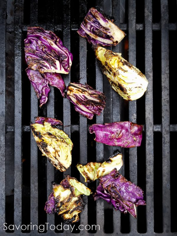 Green and purple cabbage create a beautiful side dish from the grill. Topped with classic Caesar dressing and crushed croutons, it is sure to become your new favorite from the grill.
