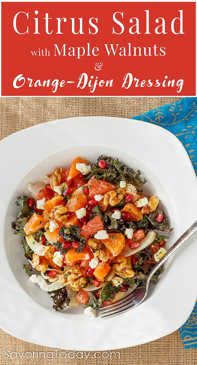 Orange, grapefruit, fennel, and kale salad with accents of pomegranate and feta in a white bowl.