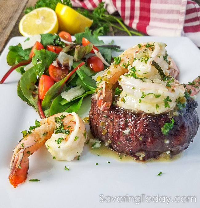 This grilled tenderloin steak tenderloin with shrimp scampi is served with a garden salad for an elegant, yet easy date night recipe dinner for two. Make reservations at your own table with restaurant quality at home.