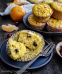 Cranberry Orange Muffin on a dark blue plate with a fork