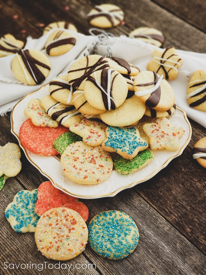 sugar cookies striped with chocolate and sugar sprinkles on a plate with a white linen napkin